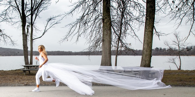 Vanessa Reiser is running 285 miles across the state of New York in 12 days while wearing her wedding dress and other bridal-inspired athletic attire to bring awareness to narcissistic domestic abuse.
