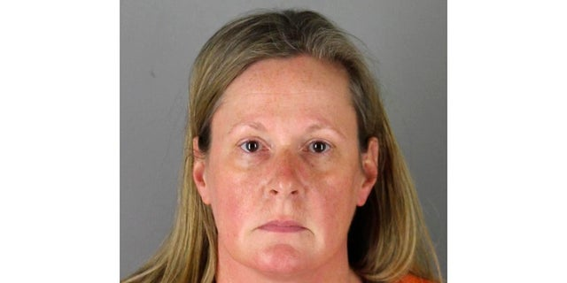 This undated booking photo released by the Hennepin County, Minn., Sheriff shows Kim Potter, a former Brooklyn Center, Minn., police officer. A Hennepin County judge set a tentativeDec. 6 trial date in her case over the fatal shooting of a 20-year-old Black motorist. (Hennepin County Sheriff via AP)