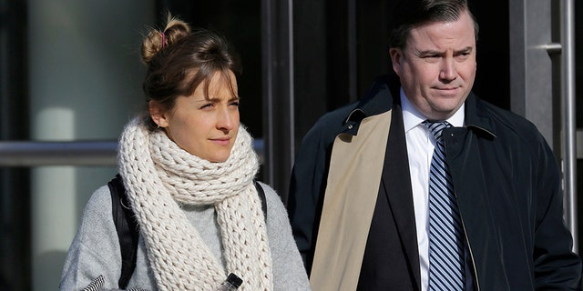 In this Dec. 6, 2018, file photo, television actress Allison Mack leaves federal court in New York.