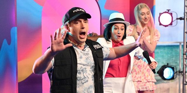"Pictured: (l-r) Beck Bennett, Melissa Villaseñor, and Heidi Gardner during a skit on ""Saturday Night Live."""