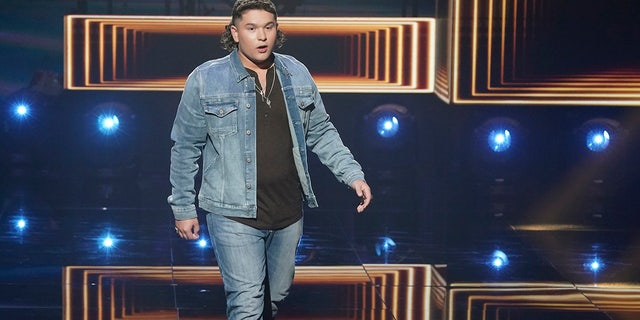 'American Idol' contestant Caleb Kennedy apologized for a video that has surfaced of him allegedly standing next to an individual who appears to wear a Ku Klux Klan hood.