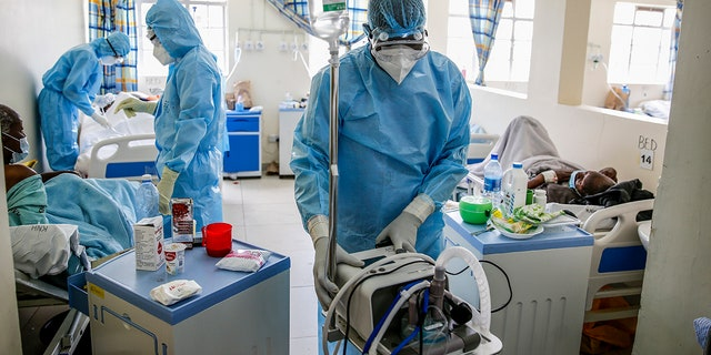 April 14, 2021: In this file photo, medical workers tend to coronavirus patients in the COVID-19 intensive care unit at Kenyatta National Hospital, in Nairobi, Kenya..
