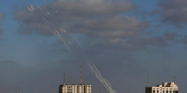 Rockets are launched from the Gaza Strip into Israel on Monday.  (AP)