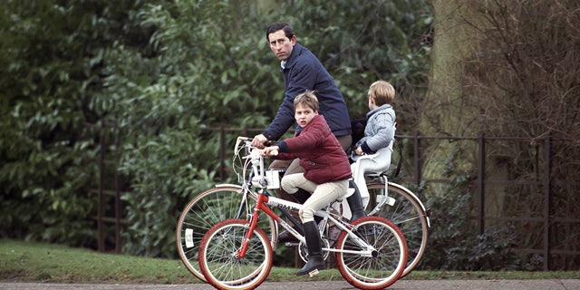 Prince Charles, Prince William And Prince Harry on bikes returning from the stables at Sandringham Estate, in Norfolk.