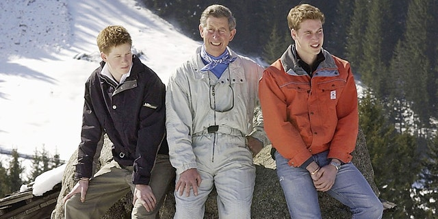 Prince Charles and his sons William (R) and Harry (L) appear at a photocall on March 29, 2002, in the Swiss village of Klosters at the start of his annual skiing holiday in the Swiss Alps.