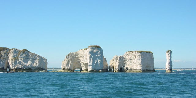 A tourist reportedly fell 120 feet off the Old Harry Rocks in Dorset, England, while the tide was in.