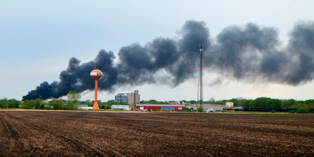 On Sunday, smoke billowed from a train derailment in Sibley, Iowa.  (AP / Sioux City Journal)
