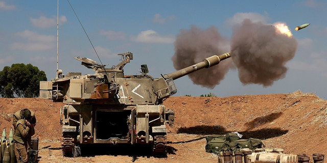 Israeli soldiers fire a 155mm self-propelled howitzer towards the Gaza Strip from their position near the southern Israeli city of Sderot on May 13, 2021. (Getty Images)