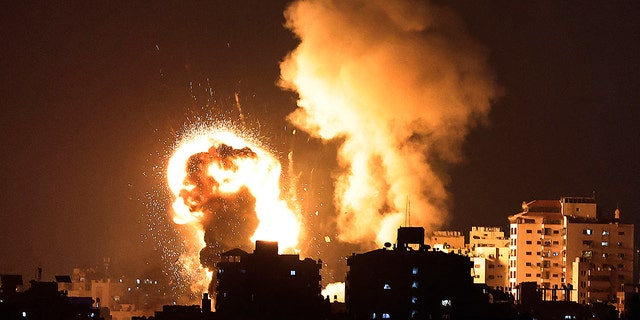 A picture shows Israeli air strikes in the Gaza Strip, controlled by the Palestinian Islamist movement Hamas, on May 10, 2021. (Photo by MAHMUD HAMS / AFP) (Photo by MAHMUD HAMS/AFP via Getty Images)