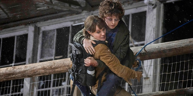 This image released by Warner Bros. Entertainment shows Angelina Jolie and Finn Little in a scene from 'Those Who Wish Me Dead.'