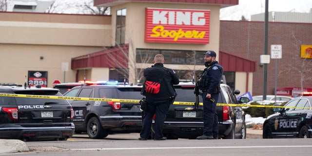 Police work the scene outside of a King Soopers grocery store on March 22 where a mass shooting took place in Boulder, Colo. (AP)