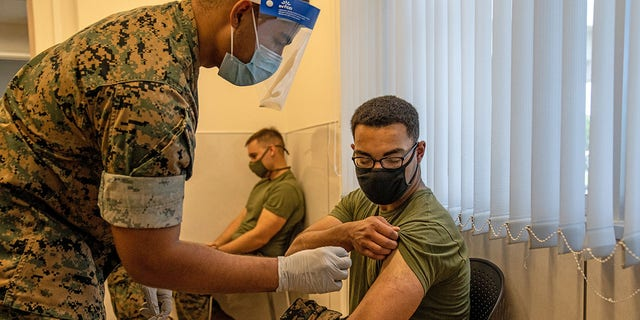 A United States Marine prepares to receive the modern coronavirus vaccine on April 28, 2021 at Camp Hansen, Kin, Japan.  (Photo by Carl Court / Getty Images)