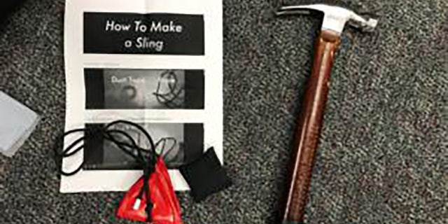 Items seized from protesters included a hammer and instructions on how to slingshot.  (Portland Police Department)