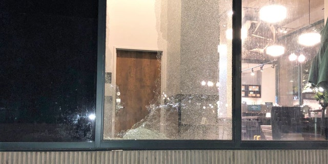 Rioters smashed a Starbucks window in downtown Portland during a night of vandalism earlier this month.