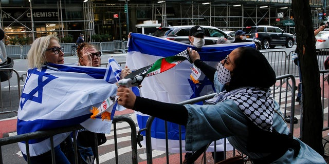 A pro-Palestinian supporter argues with Israeli supporters during a protest near the Israeli Consulate in New York City on Tuesday. (Reuters)