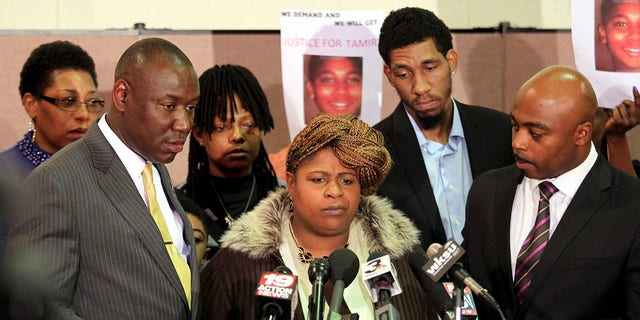 Samaria Rice (C), the mother of Tamir Rice, the 12-year old boy who was fatally shot by police last month while carrying what turned out to be a replica toy gun, speaks surrounded by Benjamin Crump (L), Leonard Warner (2nd R) and Walter Madison (R) during a news conference at the Olivet Baptist Church in Cleveland, Ohio December 8, 2014. The mother of a 12-year-old Cleveland boy fatally shot by police last month broke her silence on Monday, saying the officers involved should be criminally convicted. REUTERS/Aaron Josefczyk (UNITED STATES - Tags: CRIME LAW CIVIL UNREST)