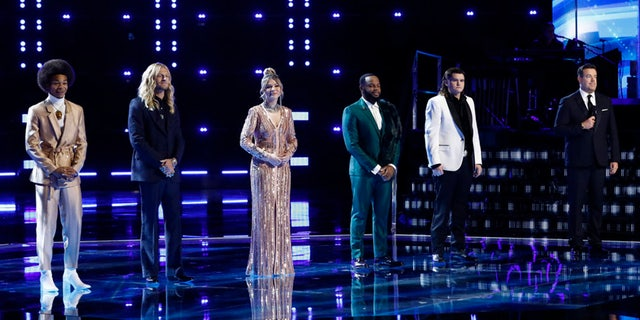 Pictured: (from left) Cam Anthony, Jordan Matthew Young, Rachel Mac, Victor Solomon, Kenzie Wheeler and Carson Daly at the final of 'The Voice' on Tuesday.