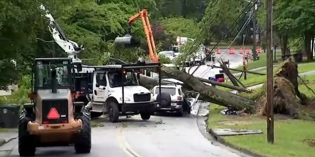 Storm damage in a neighborhood in Douglasville during tornado warnings in metro Atlanta. One fatality was reported when a tree fell on a car.