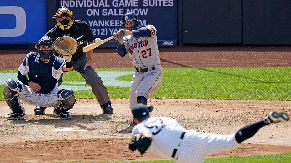 Altuve's birthday HR answers boos, Astros top Torres, Yanks