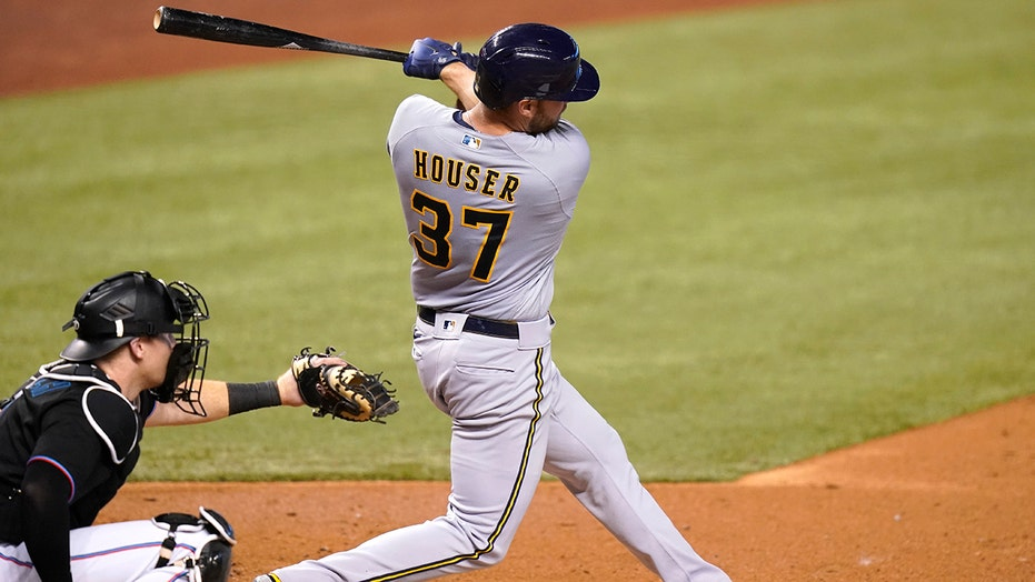 Houser homers, fans 10, Brewers stop 6-game skid, beat Miami