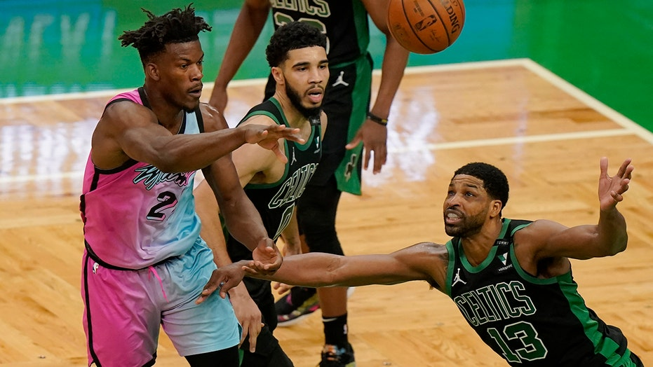 Butler strong down stretch, Heat hold off Celtics 130-124
