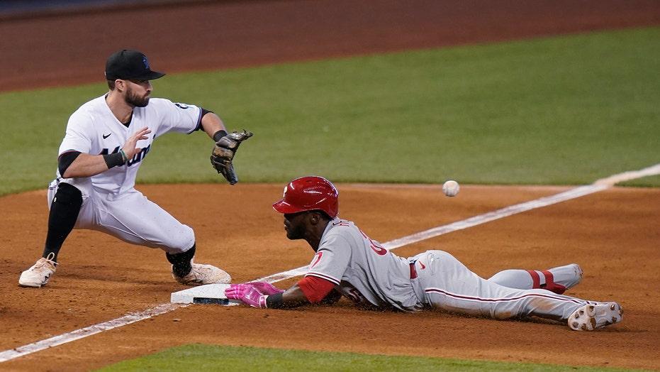 Herrera's hitting, arm helps Phillies beat Marlins 3-2