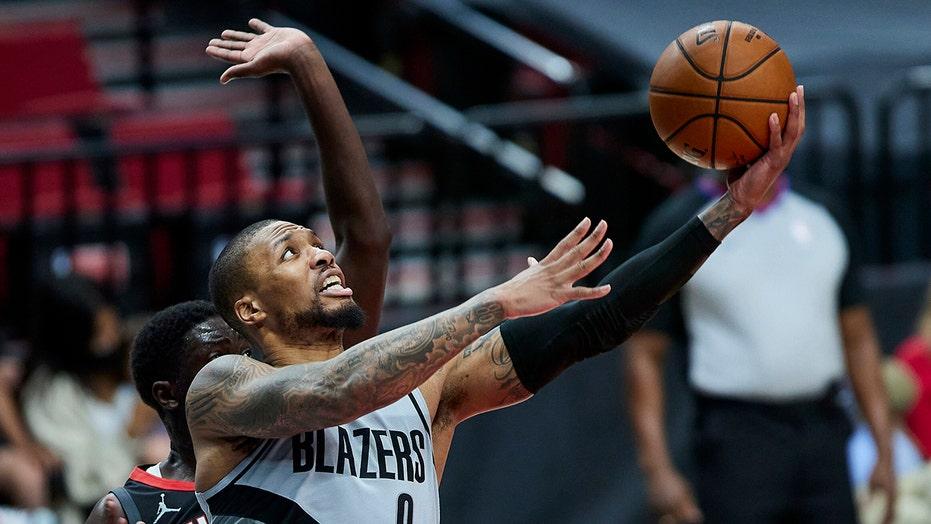 Lillard, Blazers score 50 in first, blast Rockets 140-129