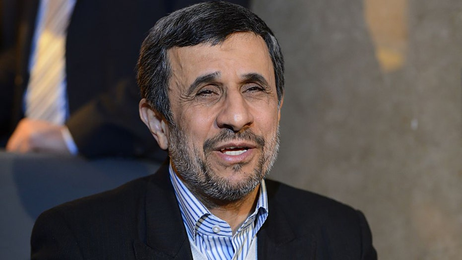 Ahmadinejad will run in presidential race, Iran state TV says