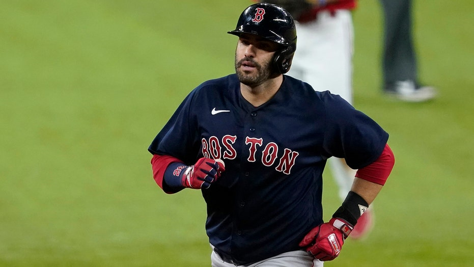 Martinez 2 HRs, leads majors with 9, as Red Sox beat Rangers