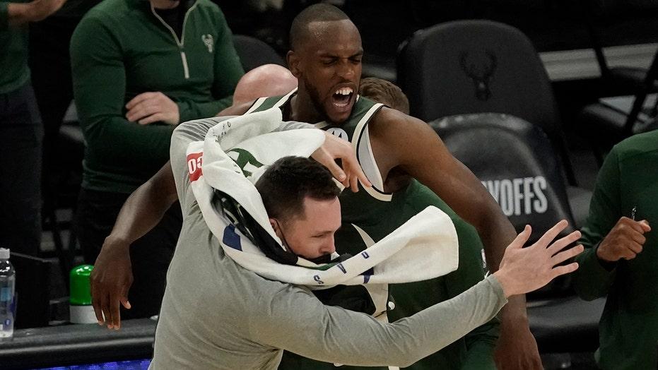 Khris Middleton lifts Bucks past Heat in OT in Game 1