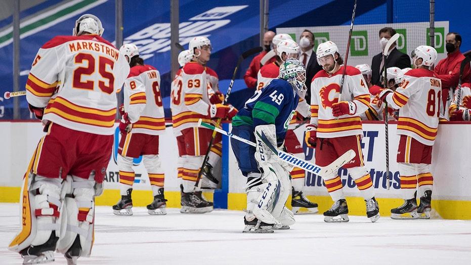 Lindholm's OT goal lifts Flames past Canucks 6-5