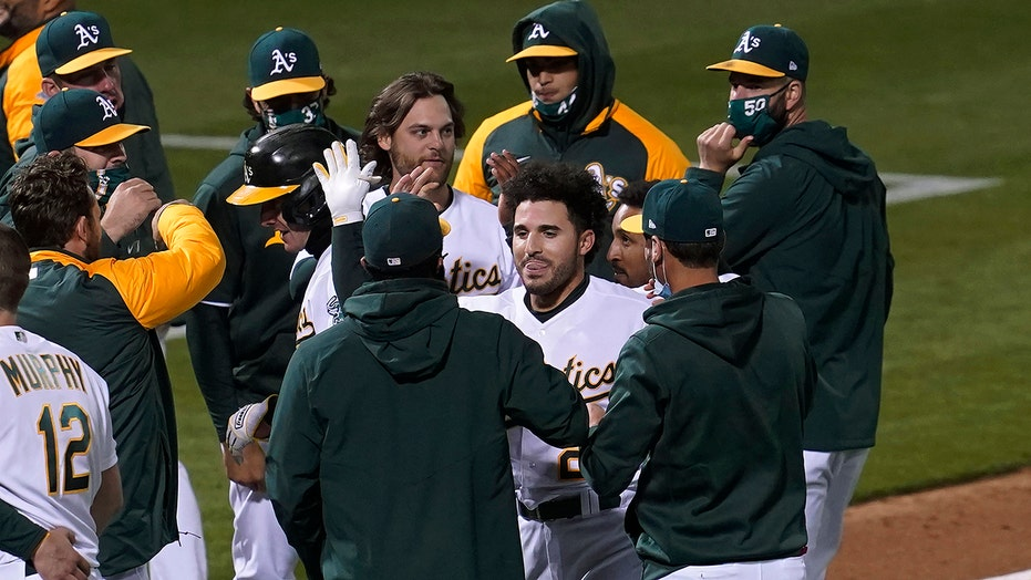 Laureano hits 2 HRs, then winning sac fly as A's beat Astros