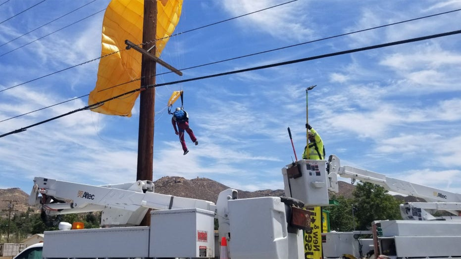 Parachuter gets caught in power lines, left dangling 30-feet in the air for over an hour