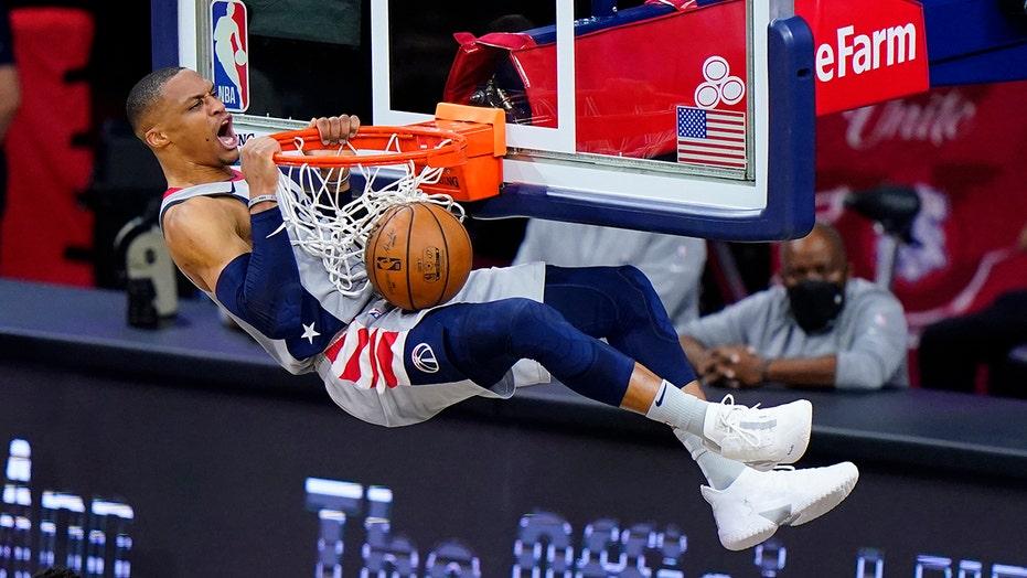 Wizards' Russell Westbrook has popcorn dumped on him as he walks to locker room