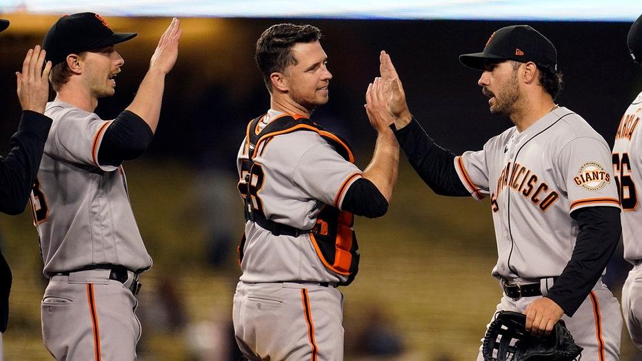 Tauchman robs Pujols of winning HR, Giants top Dodgers in 10