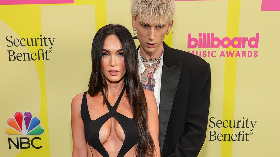 Megan Fox stuns in cleavage-bearing cut-out dress on 2021 BBMA red carpet
