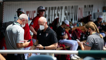 COVID-19 scare leaves Wolfpack with 13 players for CWS game
