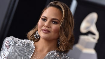 Chrissy Teigen 'stepping away from' Safely brand amid scandal 'to be with her family'