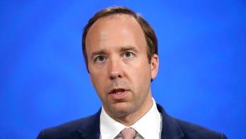 UK Health Secretary Matt Hancock resigns after images show him kissing aide