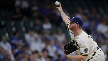 Woodruff excels, Brewers edge Cubs 2-1 for 7th straight win