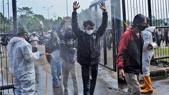 Coronavirus variants behind fresh surge in Indonesia, WHO warns