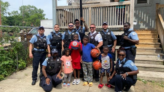 Chicago police officers surprise children with new basketball hoop after seeing them play with milk crate