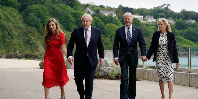 President Joe Biden and First Lady Jill Biden are greeted and walk with British Prime Minister Boris Johnson and his wife Carrie Johnson ahead of the G-7 summit on Thursday June 10, 2021 in Carbis Bay, England.  (AP Photo / Patrick Semansky)
