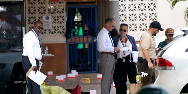 Law enforcement officials work the scene of a shooting outside a banquet hall near Hialeah, Fla., on May 30, 2021. (AP Photo/Lynne Sladky)