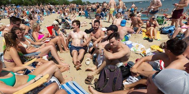 Crowds gather on L Street Beach, Saturday, June 5, 2021, in the South Boston neighborhood of Boston.