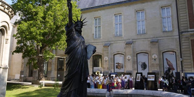 """Lady Liberty has a """"little sister"""" and she's on her way to the U.S. from France for a limited time. (AP Photo/Francois Mori)"""