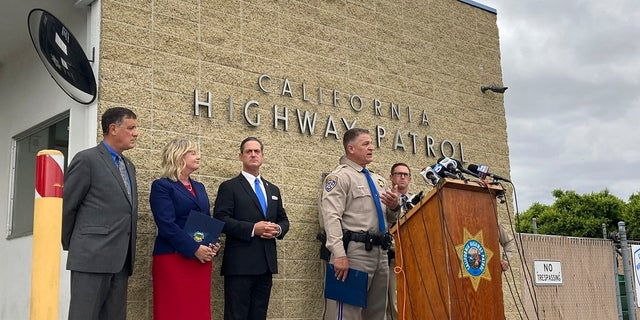 California Highway Patrol Assistant Chief Don Goodbrand talks at the podium during a news conference Monday and is joined by Orange County District Attorney Todd Spitzer third from left and other officials in Costa Mesa, Calif. (AP Photo/Amy Taxin)
