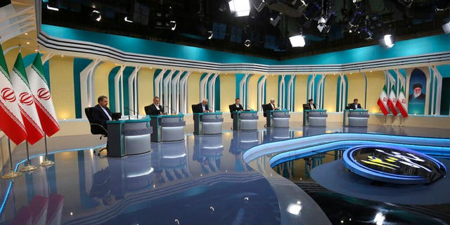 June 8, 201: In this picture made available by Young Journalists Club, YJC, presidential candidates, from left to right, Mohsen Rezaei, Alireza Zakani, Mohsen Mehralizadeh, Amir Hossein Ghazizadeh Hashemi, Saeed Jalili, Ebrahim Raisi, , and Abdolnasser Hemmati attend their second TV debate in a state-run TV studio, in Tehran, Iran. (Morteza Fakhri Nezhad/ Young Journalists Club, YJC via AP).