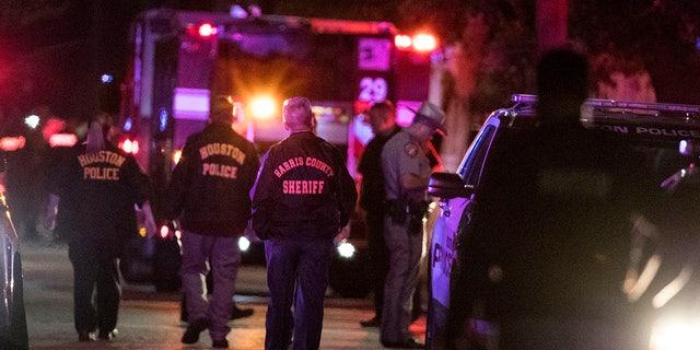 In this Monday, Jan. 28, 2019, file photo, police investigate the scene where several Houston Police officers were shot in Houston. (Brett Coomer/Houston Chronicle via AP, File)