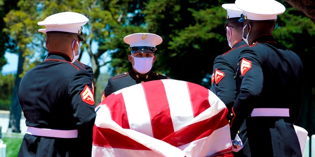 A military honor guard carries the casket of Marine Corps, Pfc. John Franklin Middleswart for a full military honors at Fort Rosecrans National Cemetery on Tuesday, June 8, 2021, in San Diego. Eighty years after he died in the attack on Pearl Harbor and just months after his remains were finally identified, the California Marine has been laid to rest with full military honors. (Nelvin C. Cepeda/The San Diego Union-Tribune via AP)